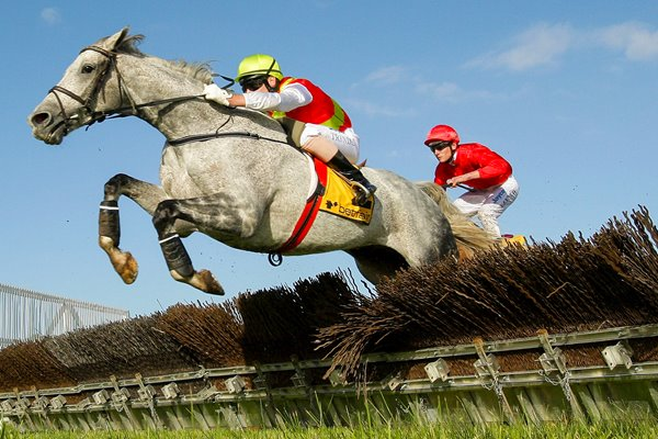 Adam Trinder riding Desert Master clears a hurdle