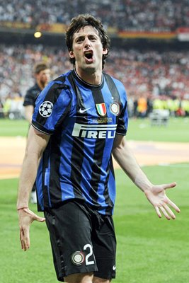 Diego Milito of Inter Milan celebrates beating Bayern