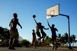Local men play basketball in Samoa Prints