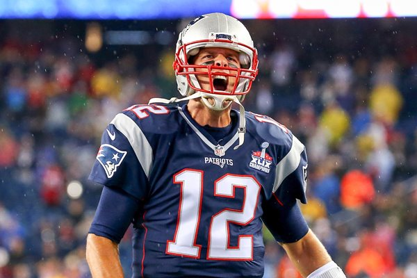 Tom Brady New England Patriots cheers as he runs
