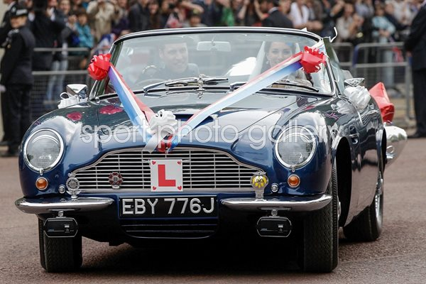 Royal Wedding Photos - Couple leave in sports car