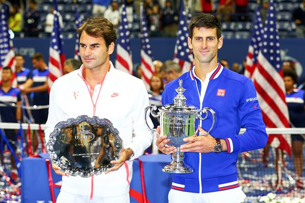 Novak Djokovic and Roger Federer with trophies US Open