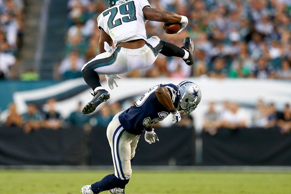 DeMarco Murray leaps over Brandon Carr