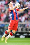 Bastian Schweinsteiger Bayern chests the ball Prints