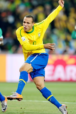 Luis Fabiano shoots and scores for Brazil
