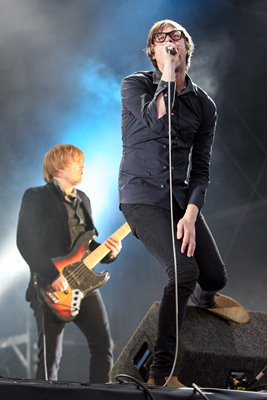 Kasabian perform onstage