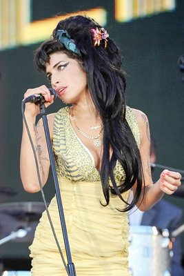 Amy Winehouse performs on stage