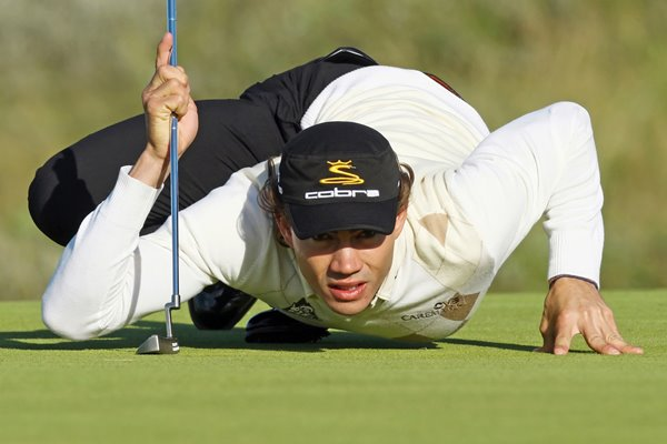Camilo Villegas takes a worms eye view of putt at Birkdale