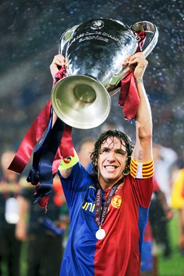 Barcelona Captain Carles Puyol lifts the trophy