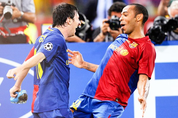 Messi celebrates with Henry after scoring for Barcelona