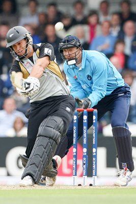 Ross Taylor of New Zealand hits through mid wicket