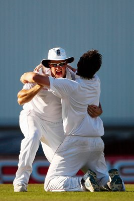 Captain and Bowler celebrate Final Wicket
