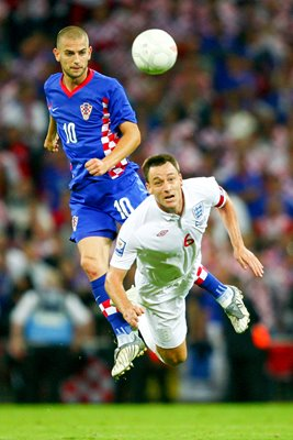 England Captain John Terry clears the ball away