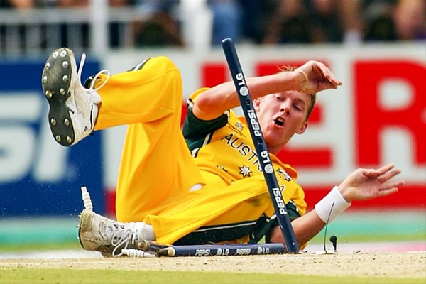Brett Lee crashes through the stumps