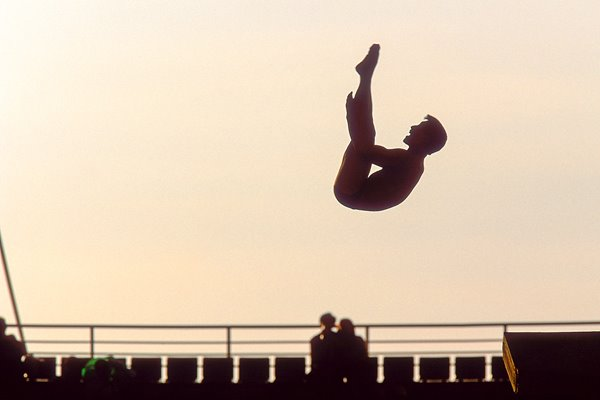 Silhouette of a diver in action