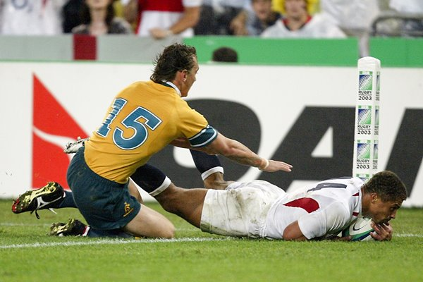 Jason Robinson of England dives over for a try