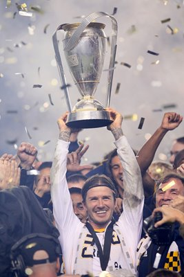 David Beckham lifts the 2011 MLS Cup
