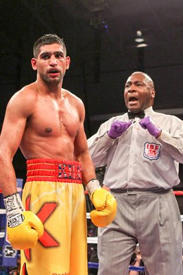 Referee Joe Cooper penalises Amir Khan 2011
