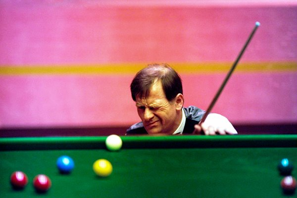 Alex Higgins of Ireland lines up a shot during the 1994 Embassy World Snooker Championships