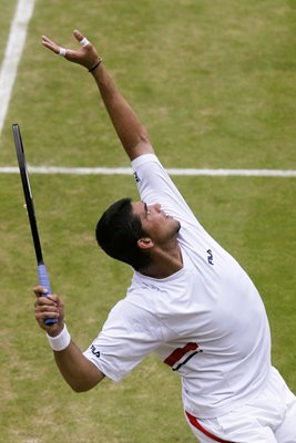 Mark Philippoussis serves