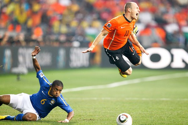 Arjen Robben dives over the Brazilian tackle