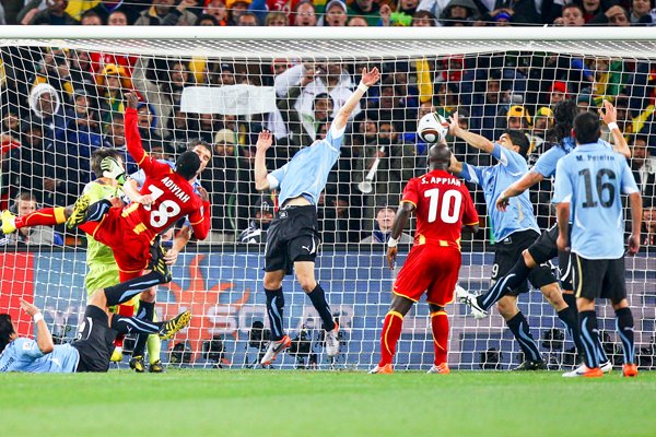 Luis Suarez of Uruguay handles the ball v Ghana