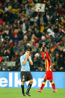 Luis Suarez of Uruguay is sent off