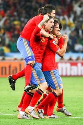 Spain team mates celebrate scoring v Germany