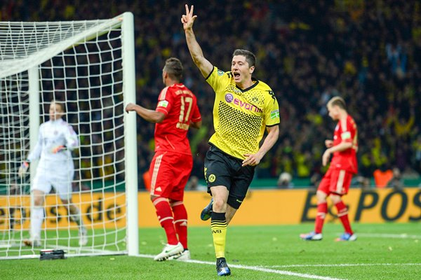 Robert Lewandowski celebrates scoring his third v Bayern Munich