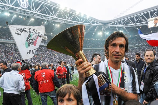 Andrea Pirlo celebrates with the Serie A trophy