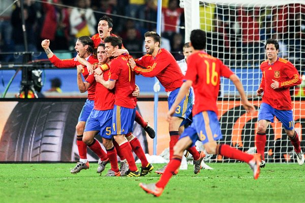 Carles Puyol of Spain celebrates with his team mates
