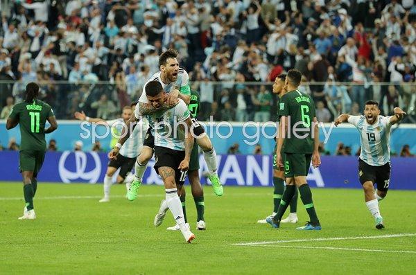 Marcos Rojo & Lionel Messi Celebrate Argentina V Nigeria