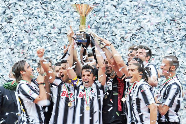 Juventus players celebrate winning SERIE A