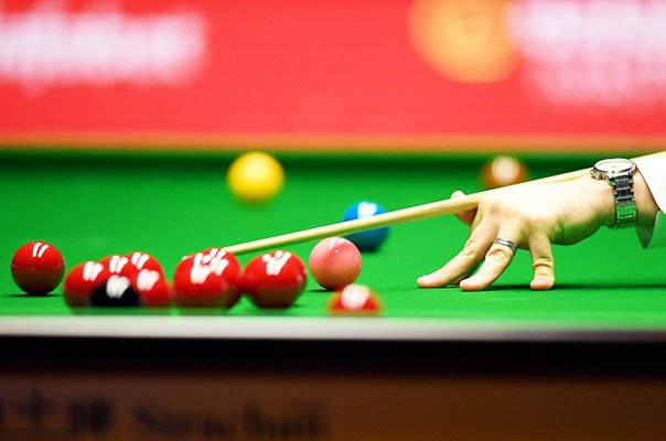 Snooker player cue and snooker balls Masters 2020