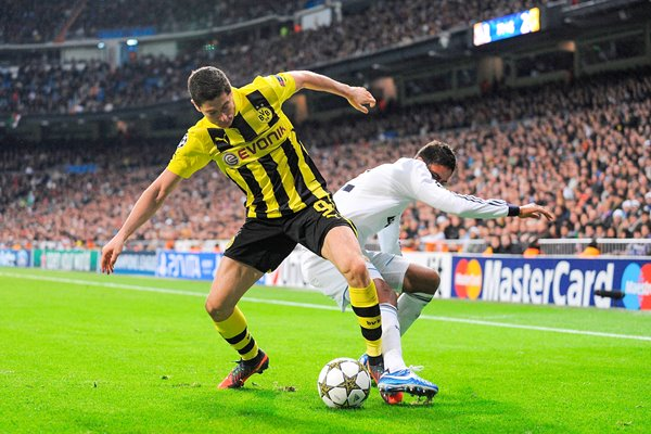 Robert Lewandowski of Borussia Dortmund battles the ball