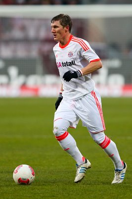 Bastian Schweinsteiger of Muenchen runs with the ball