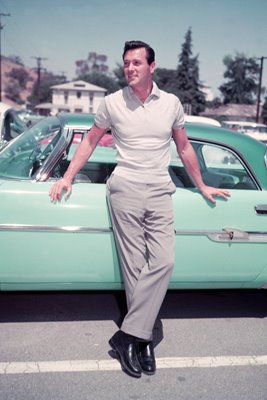 Rock Hudson leaning on car 1955