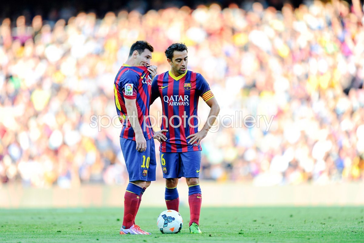 Lionel Messi and Xavi Hernandez