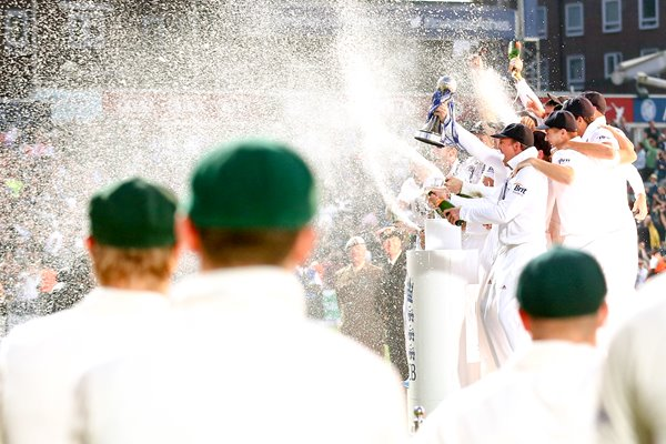 Australian players look on as England lift the urn Ashes 2013