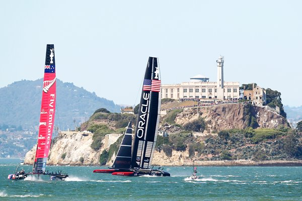 USA and New Zealand race beneath Alcatraz America's Cup 2013