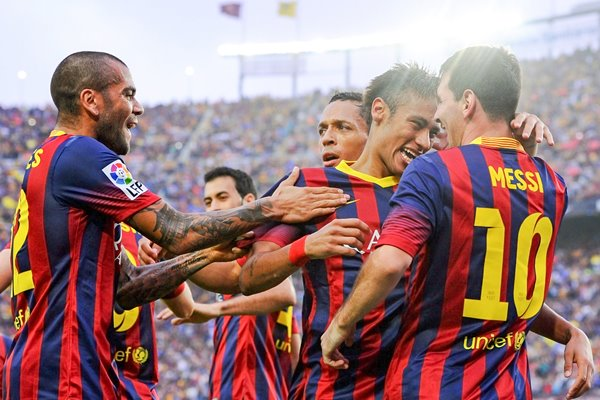 Neymar celebrates with Lionel Messi and team mates
