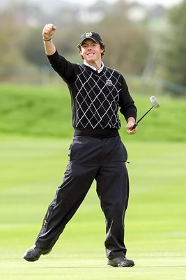 Rory McIlroy celebrates Foursomes Day 2 putt