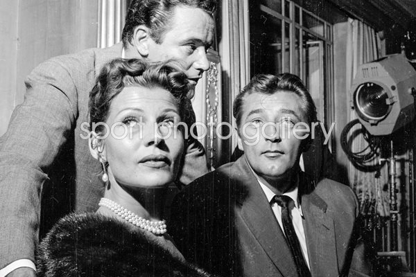 Rita Hayworth, Jack Lemmon and Robert Mitchum 1956