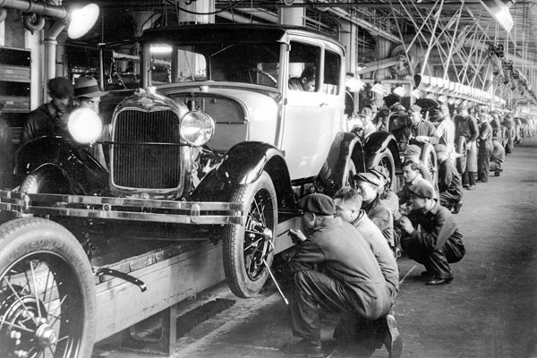 The production line at a Ford Motor Factory in the 1920s
