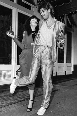 Kate Bush and Bob Geldof dance in celebration