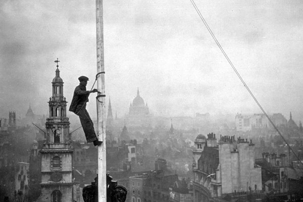 Steeplejack with view over London behind 1934