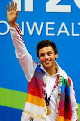 Tom Daley poses with gold medal