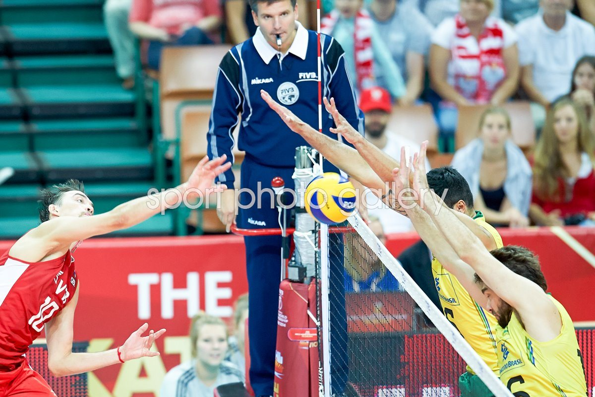 Sergey Savin of Russia spikes the ball v Brazil