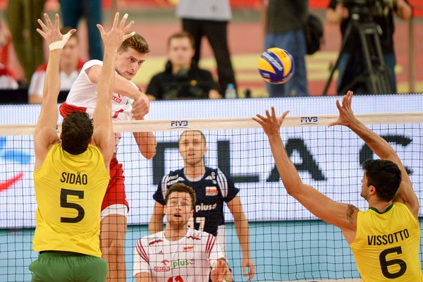 Piotr Nowakowski Poland spikes the ball v Brazil