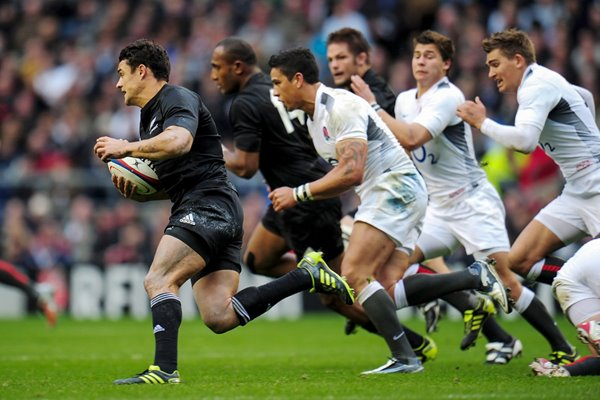 Dan Carter of New Zealand makes a break v England